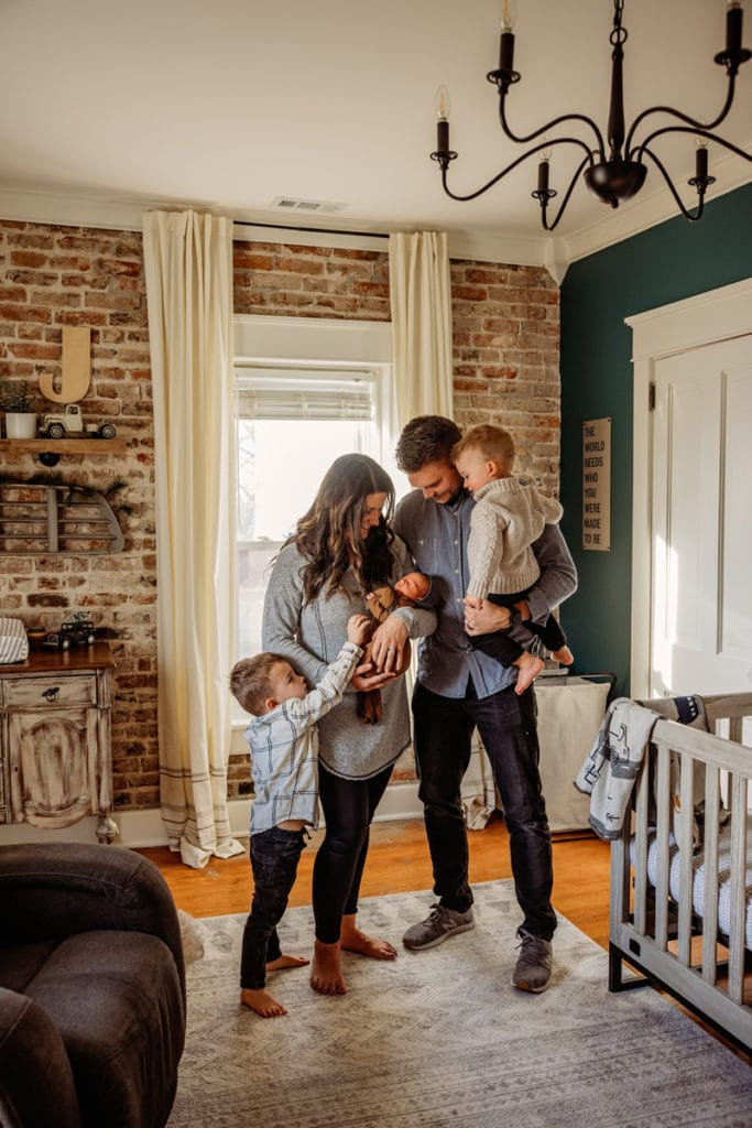 Newborn photographer, young family with two toddlers welcome baby home